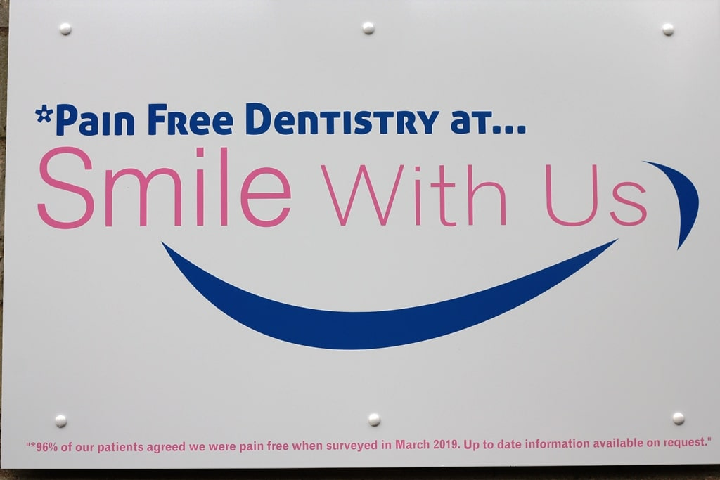 pain free dentist smile with us